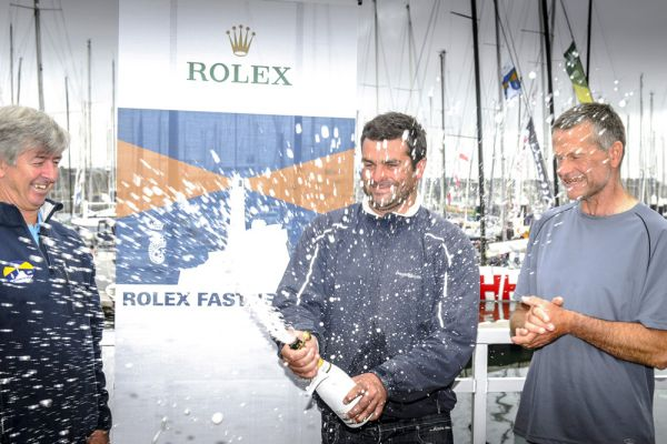 L-R: The RORC CEO Eddie Warden Owen congratulates IRC Overall winners of the 2013 Rolex Fastnet Race, Alexis and Pascal Loison. Photo: Rolex/Kurt Arrigo