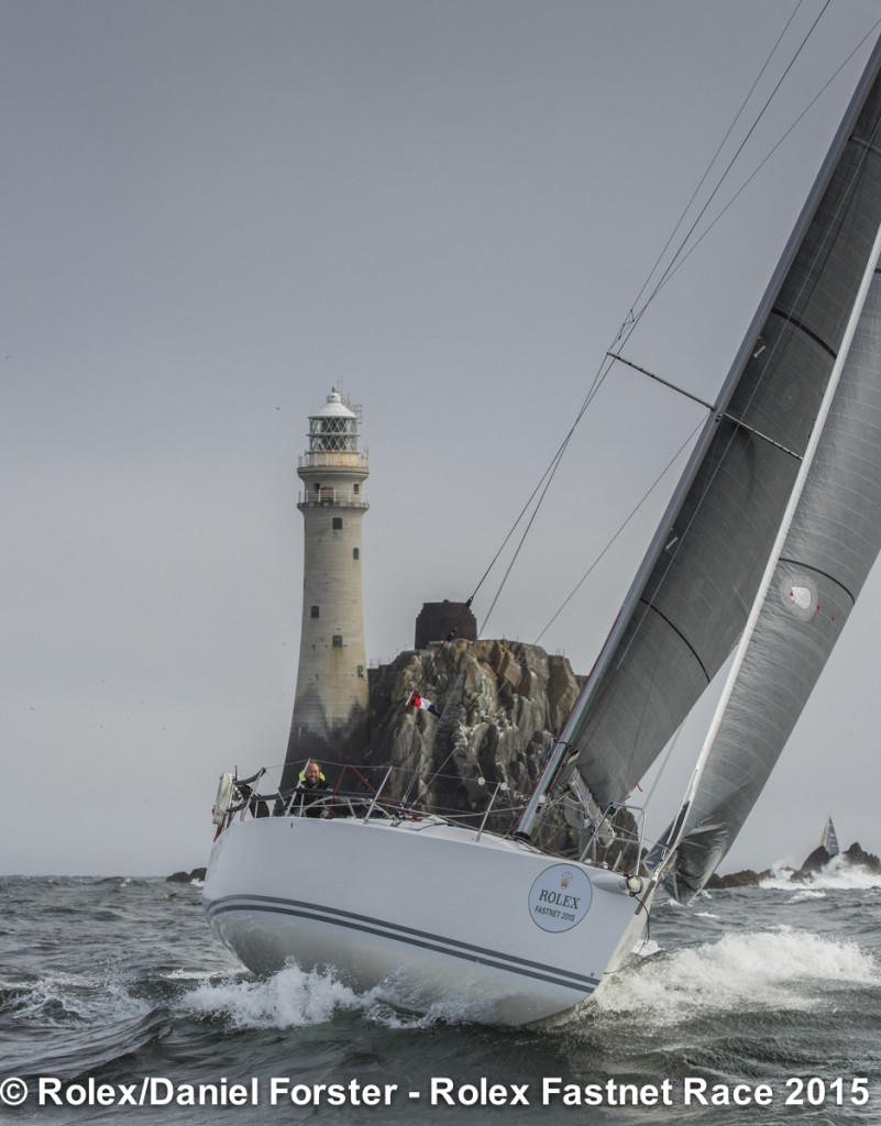 Boo, Neil McGrigor's two-handed J/109, rounds the Fastnet Rock. Photo: Rolex/Daniel Forster