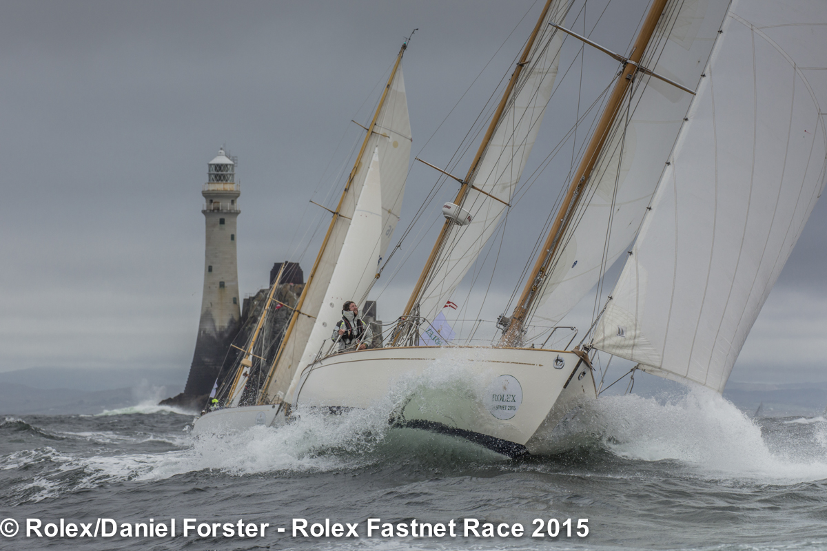 Stormy Weather of Cowes and Dorade round the Fastnet Rock within touching distance of each other. Photo: Rolex/Daniel Forster