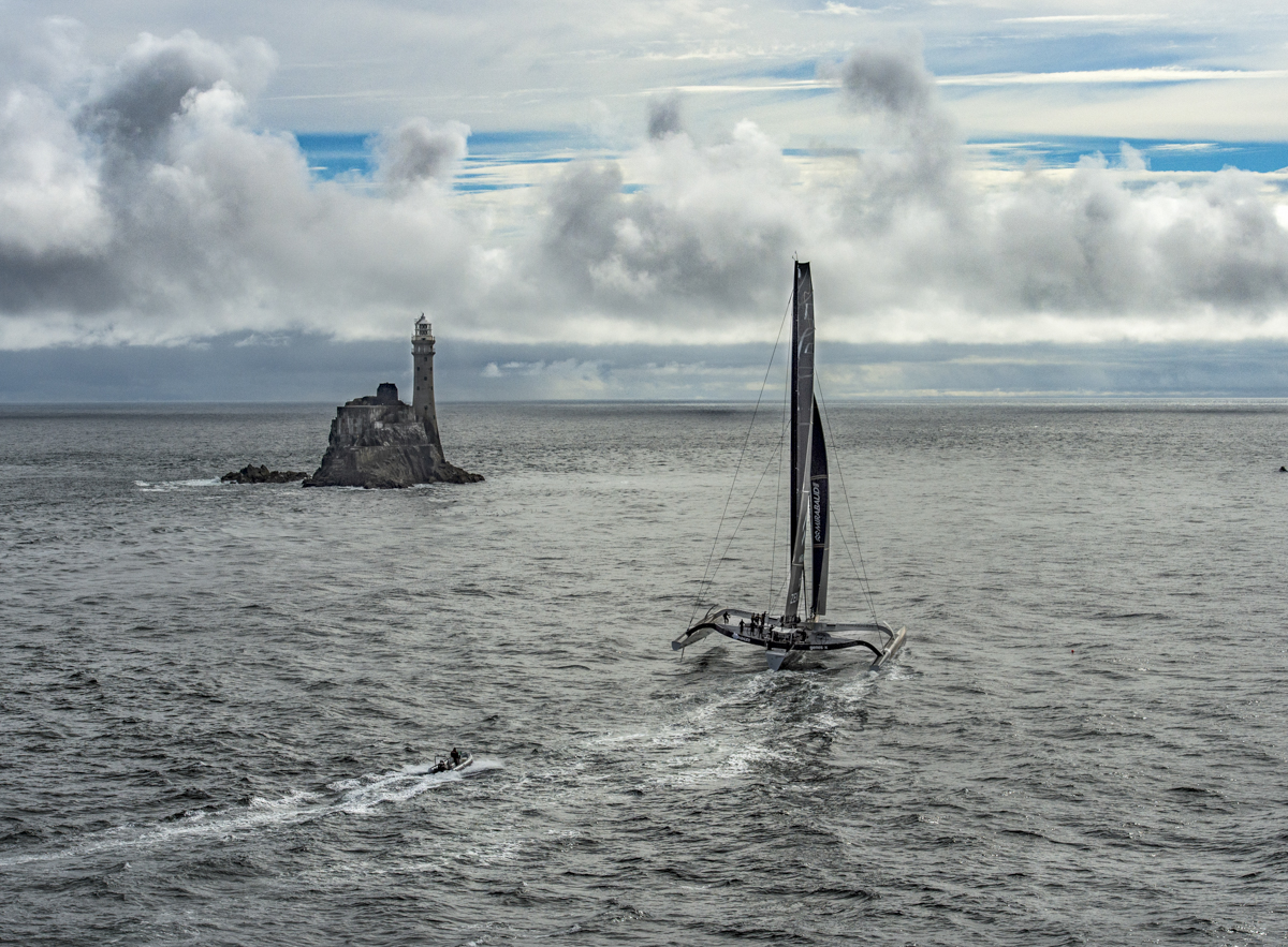 Spindrift 2, 40m maxi trimaran, rounds the Fastnet Rock first. Photo: Rolex/Kurt Arrigo