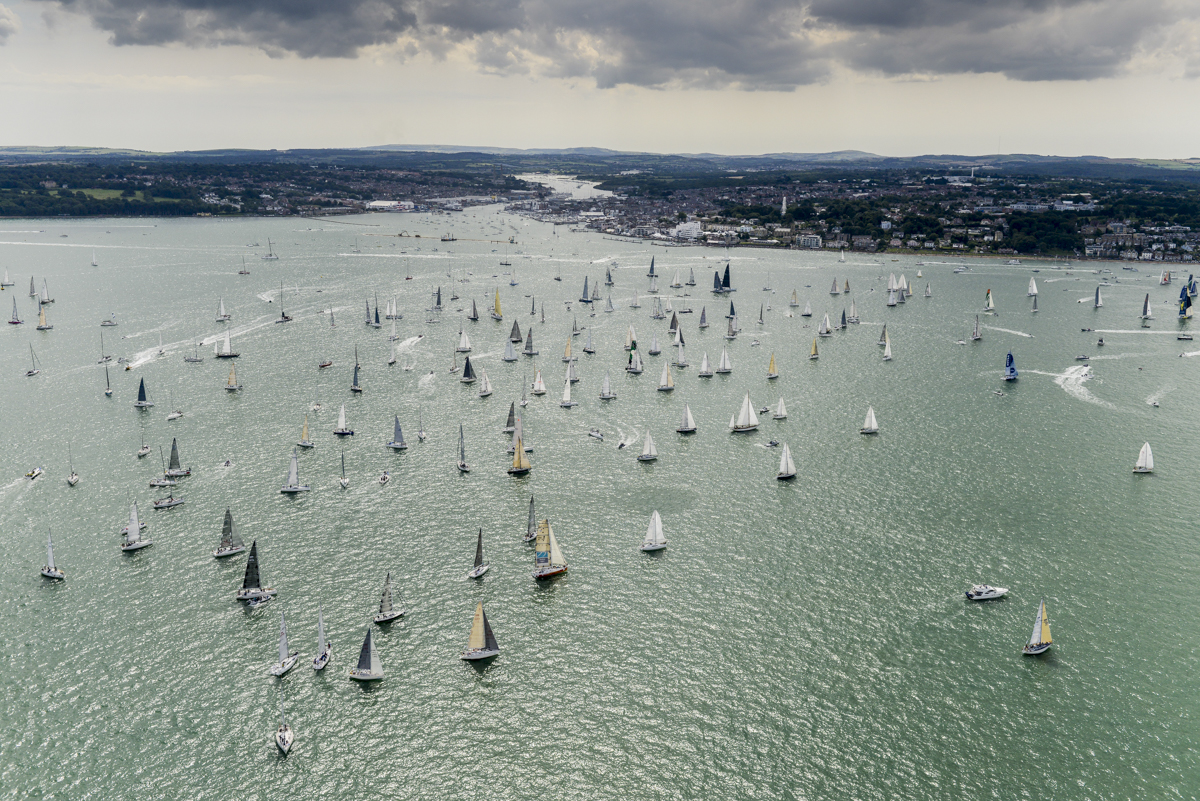 The record fleet of 365 boats gather in the Solent for the start of the 46th edition of the Rolex Fastnet Race. Photo: Rolex/Kurt Arrigo