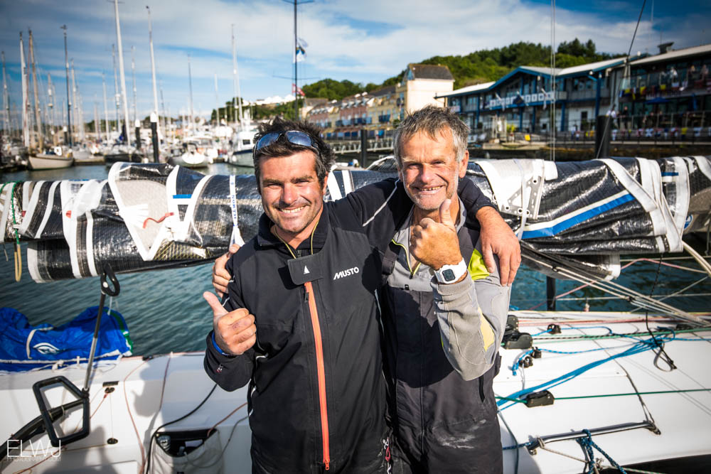 Pascal and Alexis Loison, father and son racing doublehanded in IRC Four on Night and Day, celebrating their finish in Plymouth. Credit: ELWJ Photography/RORC