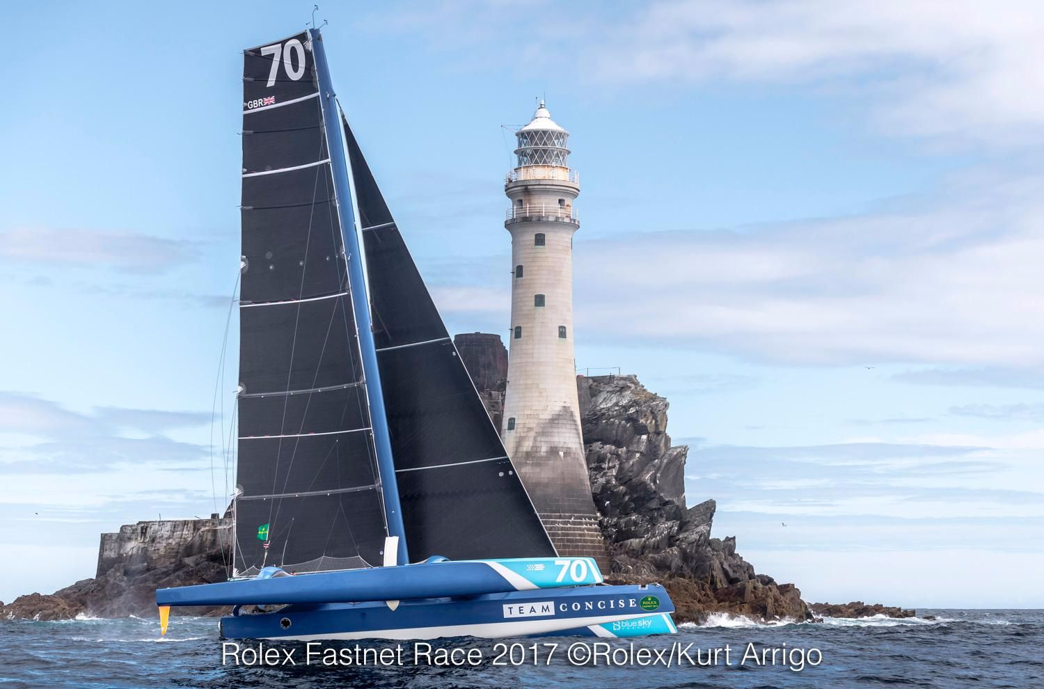 Concise 10, the Ned Collier-Wakefield skippered MOD 70, was the first round the Fastnet Rock on Monday 7 August. Credit: ROLEX/Kurt Arrigo