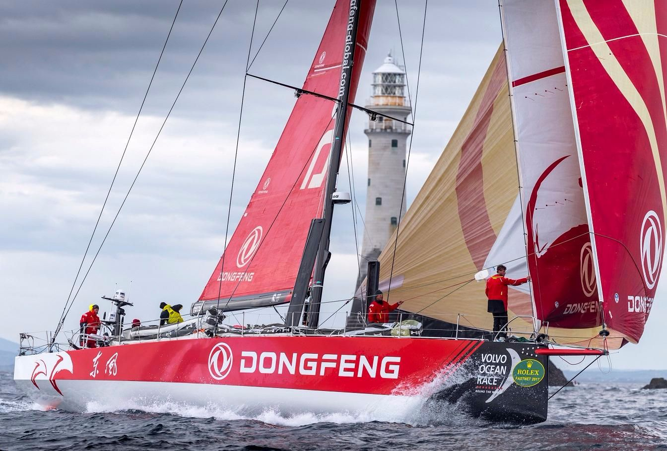 VO65 Dongfeng are the first of their class to round the Fastnet Rock. Credit: ROLEX/Kurt Arrigo