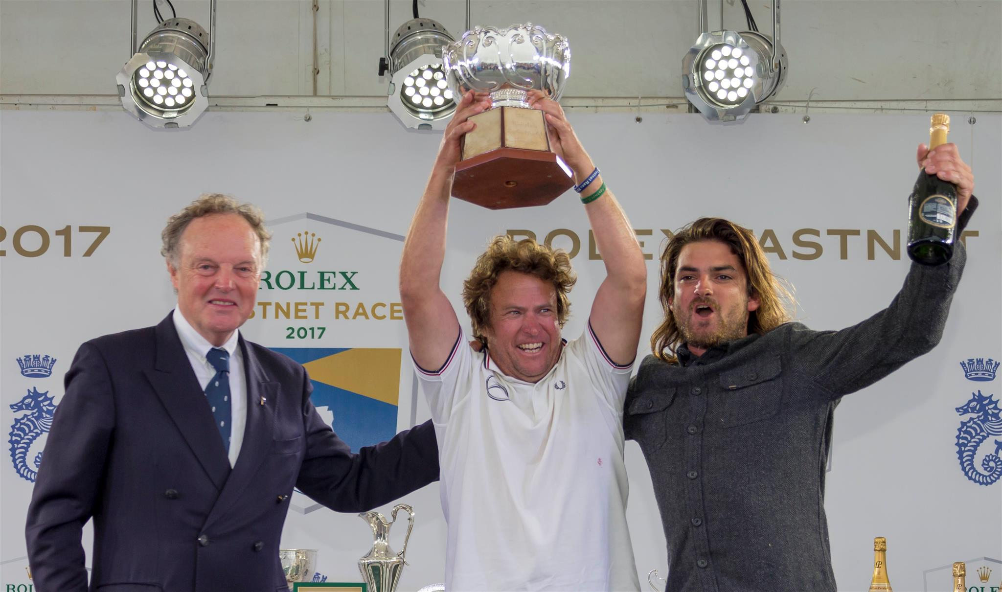 The team from Italy and Chile onboard Swan 57, Equinoccio, celebrate their awarding of the Coates Schofield Trophy. Credit: ROLEX/Carlo Borlenghi