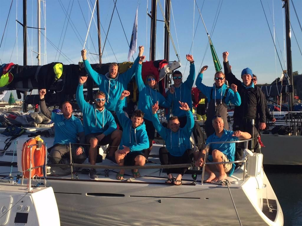 The crew of Lisa, the First 44.7, owned by Nick and Suzi Jones and sailed by Michael Boyd, celebrate their finish in Plymouth. Credit: RORC/Trish Jenkins