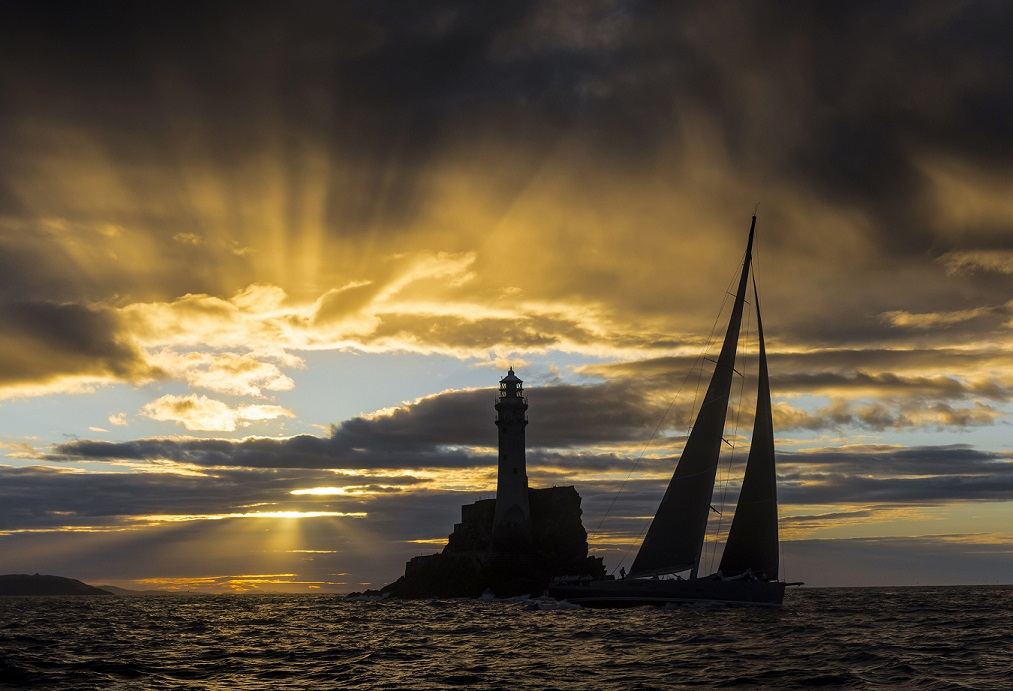 Nikata round the iconic Fastnet Rock in front of a spectacular sunset. Credit: ROLEX/Kurt Arrigo