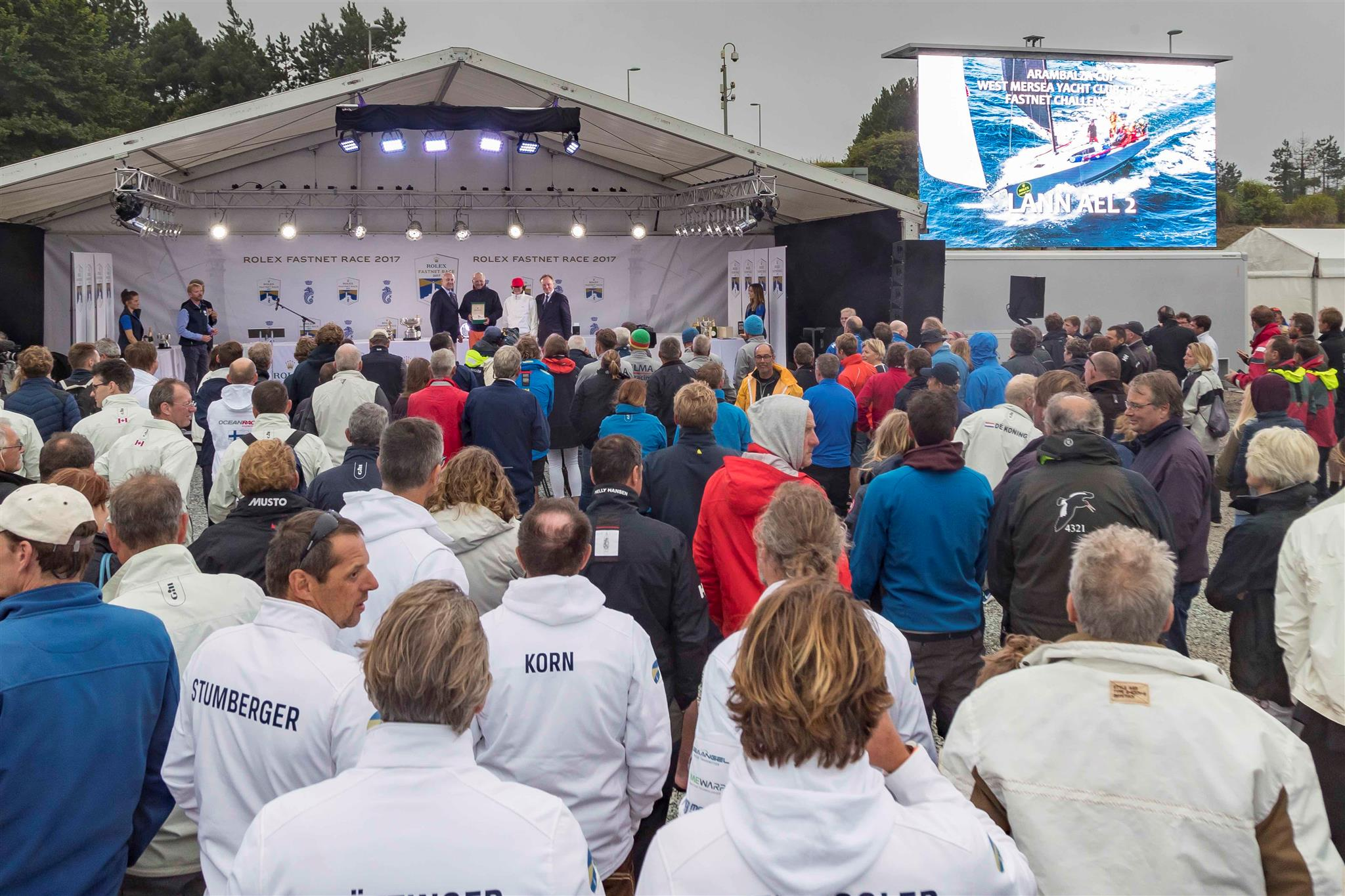 The crowds gathered in the Rolex Race Village for the prizegiving on Friday night, the presentation bookended by the thrilling video footage of the race. Credit: ROLEX/Carlo Borlenghi