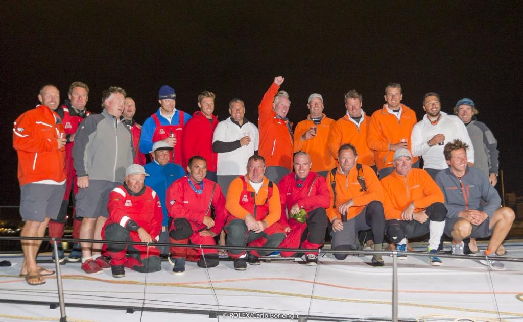 Rambler 88 crew celebrating their monohull line honours victory in the Rolex Fastnet Race © Rolex/Carlo Borlenghi