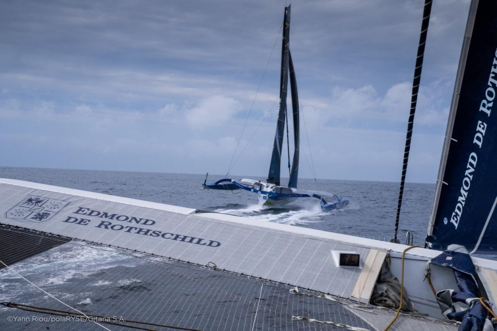 Match-racing Ultims MACIF and Edmond de Rothschild rounded the Fastnet Rock within 2 minutes of each other © Yann Riou