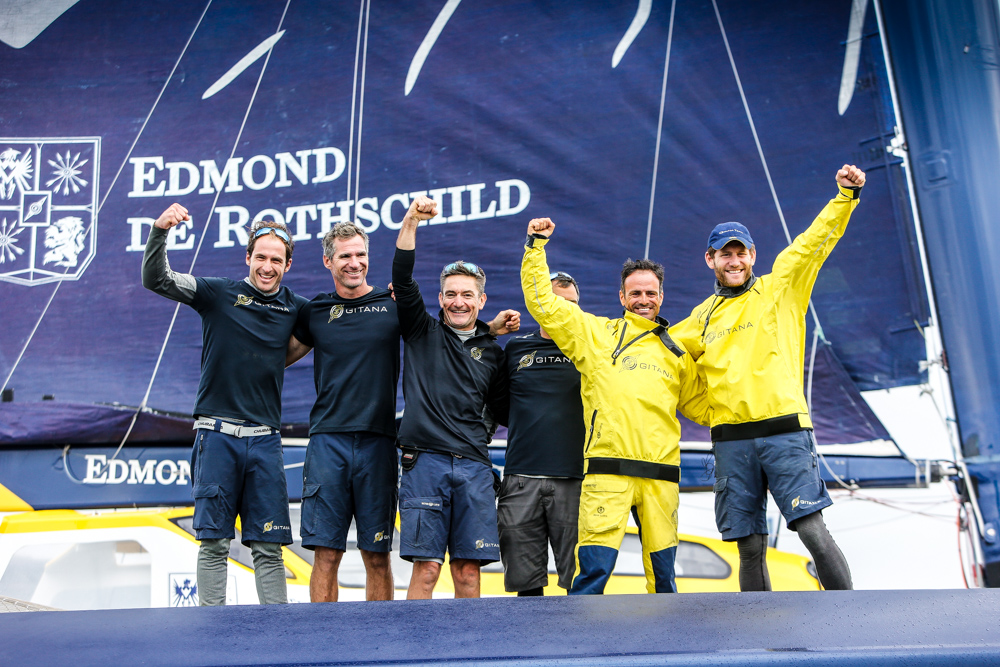 The crew of Maxi Edmond de Rothschild celebrate their record-breaking race today © Paul Wyeth/www.pwpictures.com