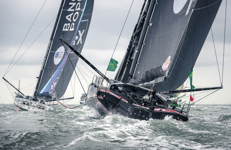 Jeremie Beyou's Charal chasing down Banque Populaire at the start of the Rolex Fastnet Race © Kurt Arrigo/Rolex