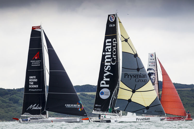 Giancarlo Pedote's Prysmian Group, Sam Davies and Paul Meilhat's Initiatives Couer and Boris Herrmann's Malizia - Yacht Club de Monaco cruise past the shoreline at the start of the Rolex Fastnet Race © Paul Wyeth/www.pwpictures.com